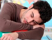 teen_boy_girl_asleep_school_shutterstock_91930403